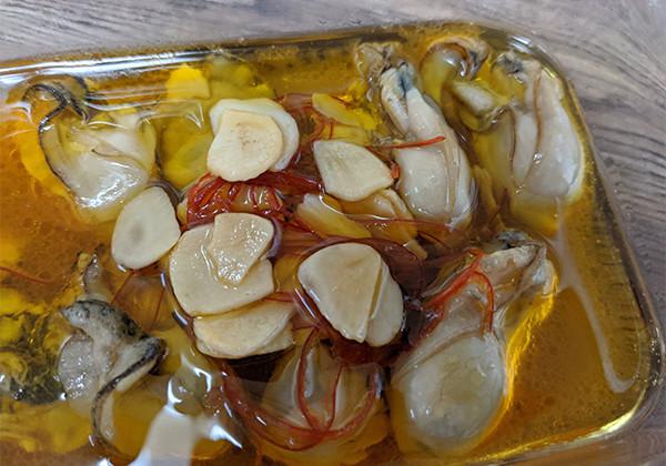 牡蠣のガーリックオイル漬けの画像